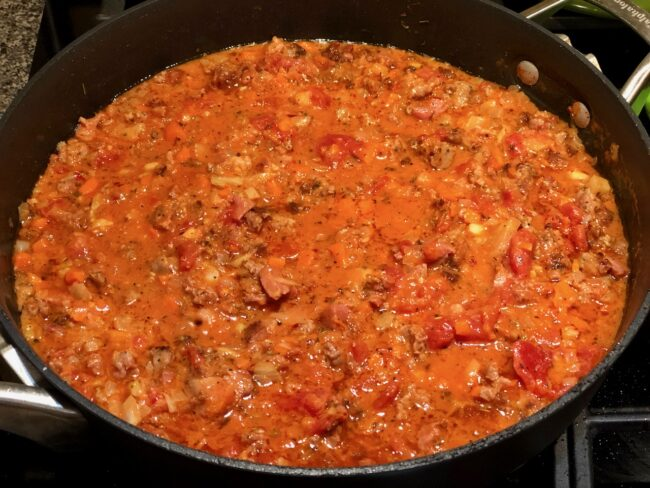 Simmering pasta sauce for Rigatoni with sausage and fennel