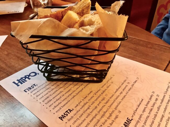 Focaccia bread basket on the table at Hippo Highland Park