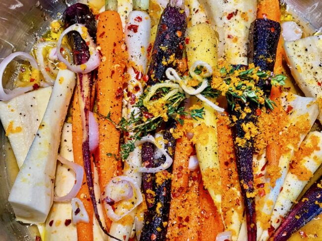 Barefoot Contessa's Orange-Braised Carrots and Parsnips with crushed black pepper