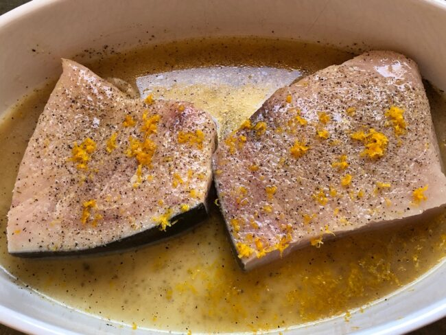 two pieces of swordfish marinating
