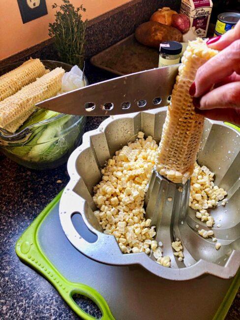 slicing off corn kernels