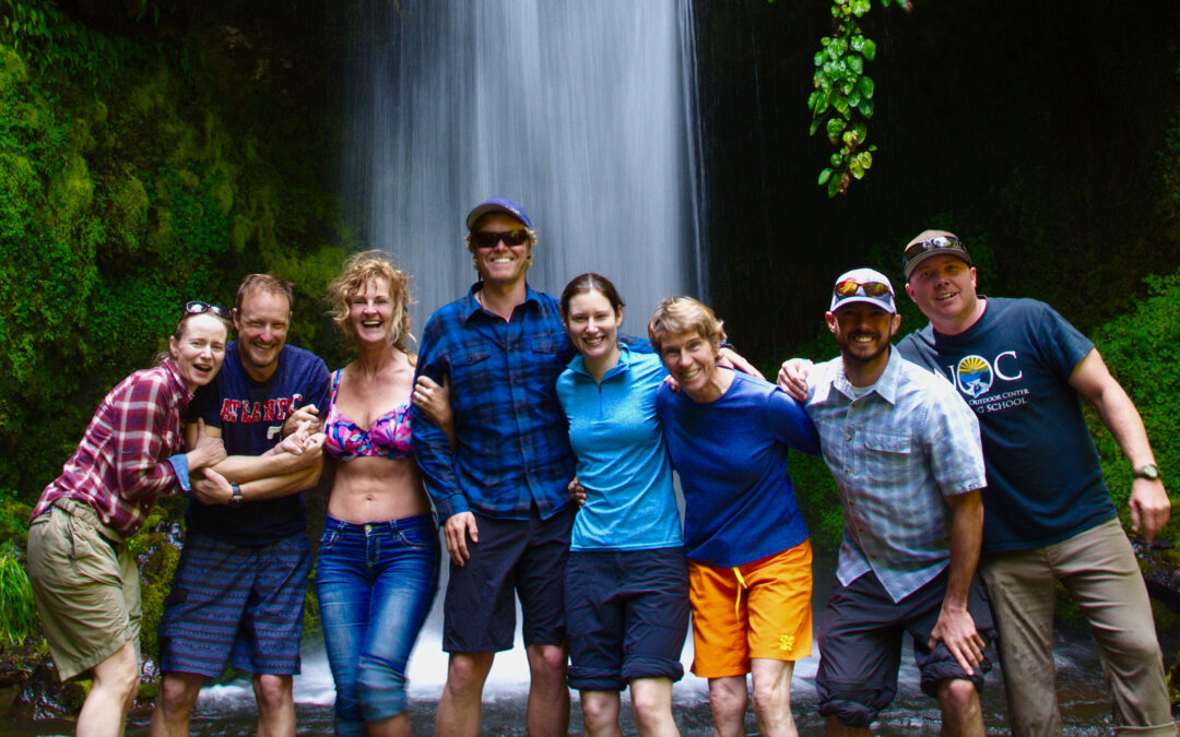 Group in Front of Waterfall in Chile
