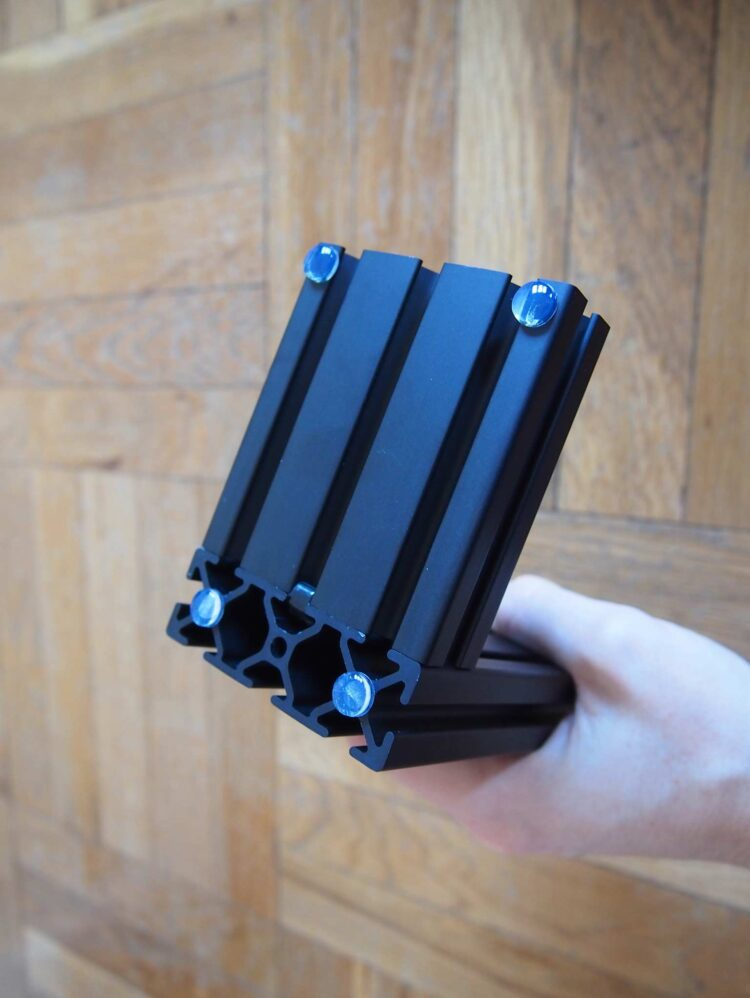 10   Place bumpers along the underside of the bookend, as photographed, and press down firmly. Repeat steps 1-10 to produce your second bookend.