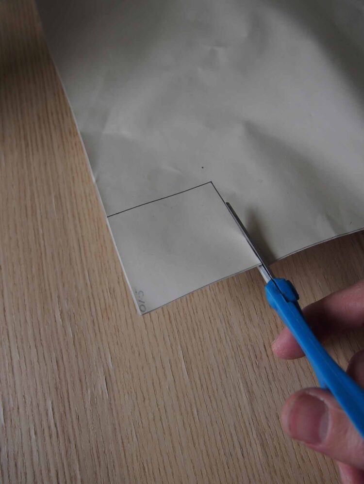 2   With scissors, cut a 6cm x 6cm square from the rubber sheet.