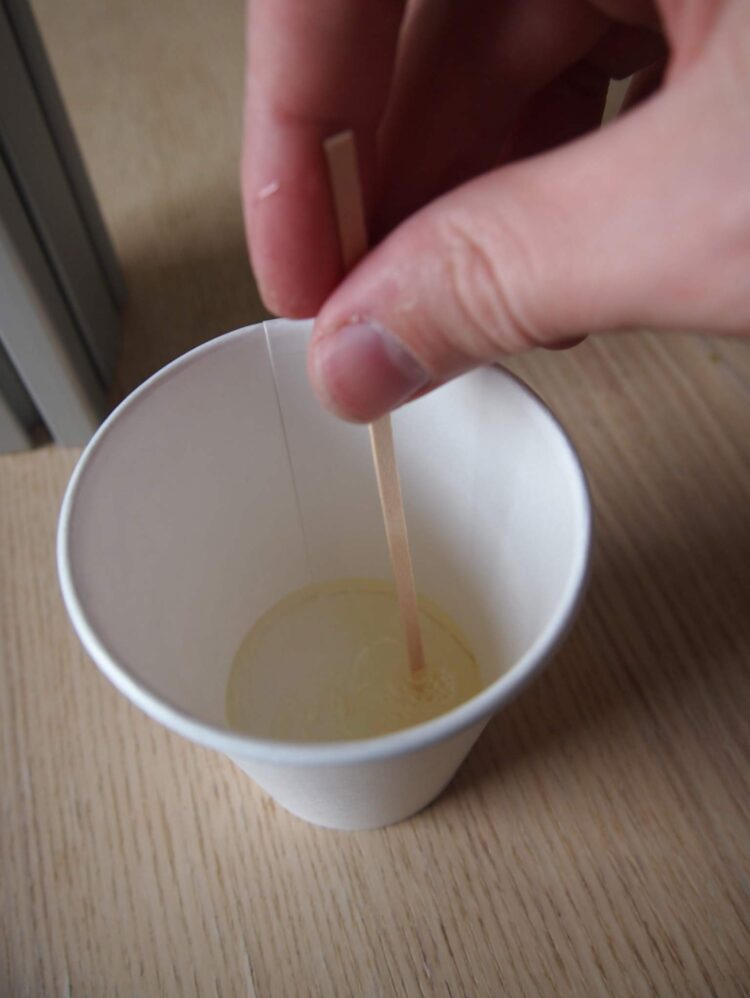 6   Mix thoroughly with a disposable mixer.