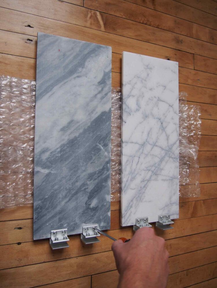 4   Tighten the brackets to the long tiles. Do not over-tighten, but make sure the brackets are very firmly gripping the tile.