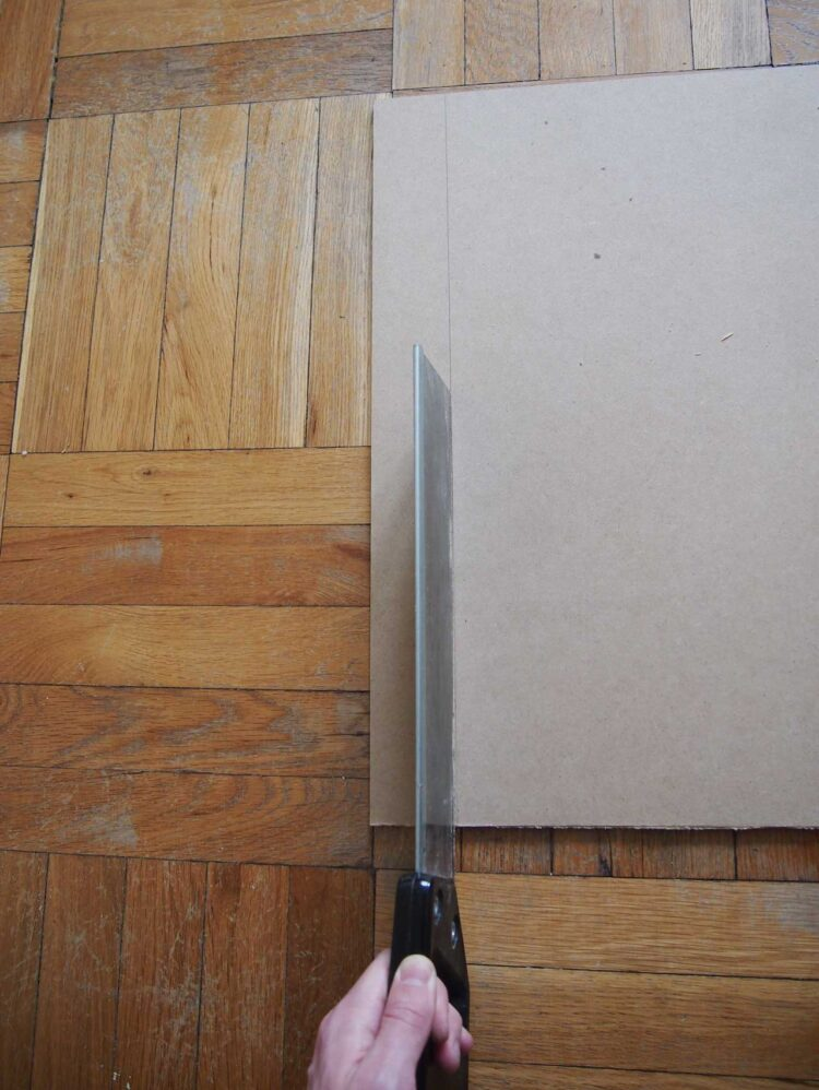 10   With a hand saw, trim your MDF board so it is only 108cm (42.5in) in length.
