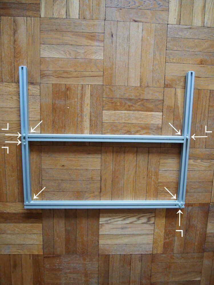 13   Repeat step 12 with four new frame pieces. The positioning of the small brackets will be the only difference with this step.