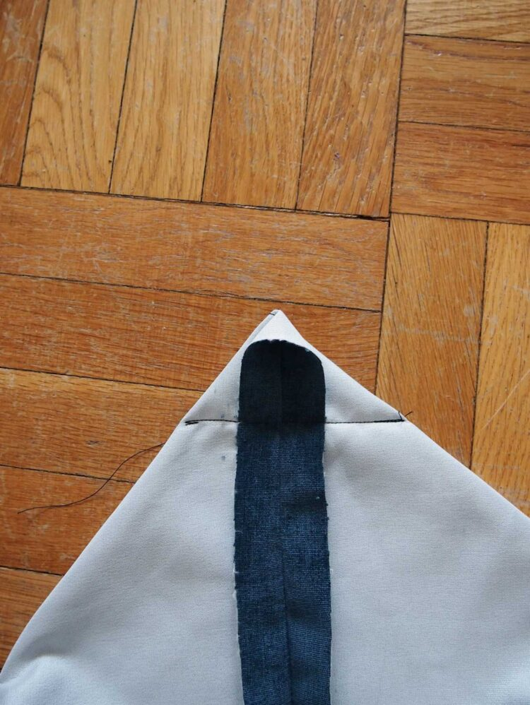 20   Repeat this process for the remaining 3 corners and the remaining 5 pieces of fabric. To visualize how this will affect your fabric's shape before you sew, pin or clip along the sewing lines and turn the fabric inside out.