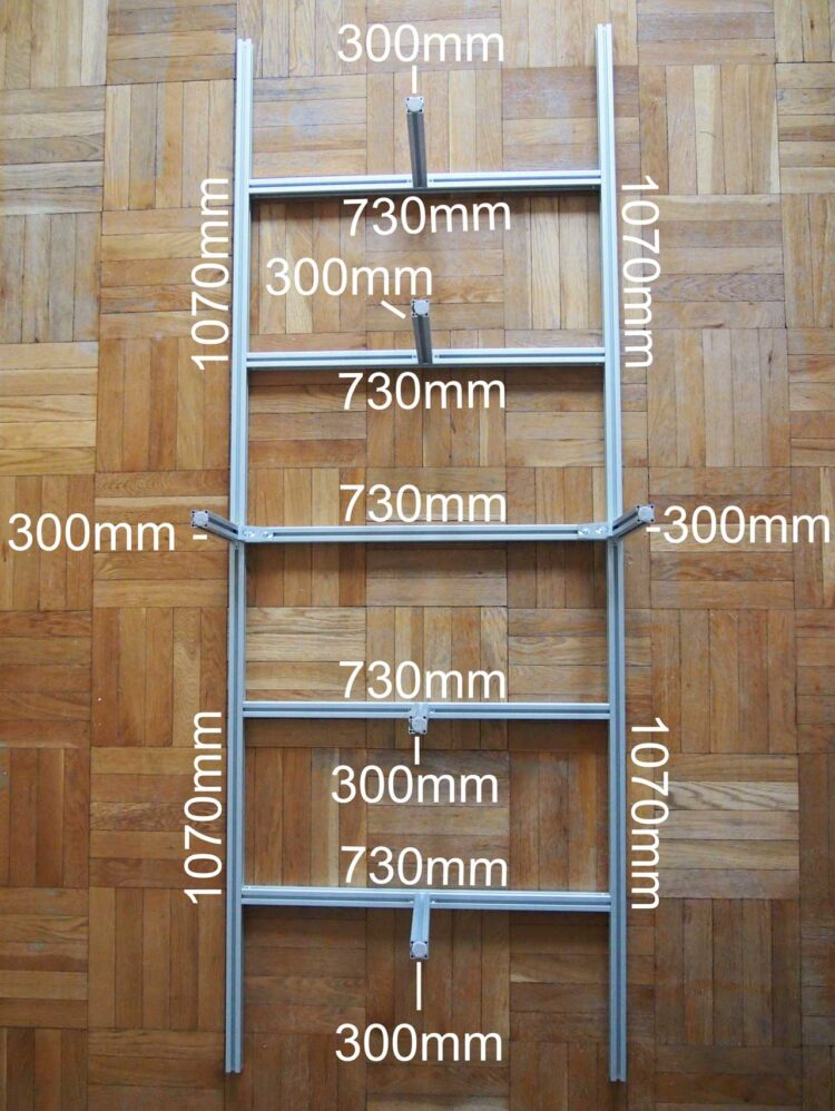 6   Arrange the following pieces of the frame on a large flat space as pictured. Four 1070mm pieces, Five 730 mm pieces, and Six 300mm pieces. Take care not to scratch the frame.
