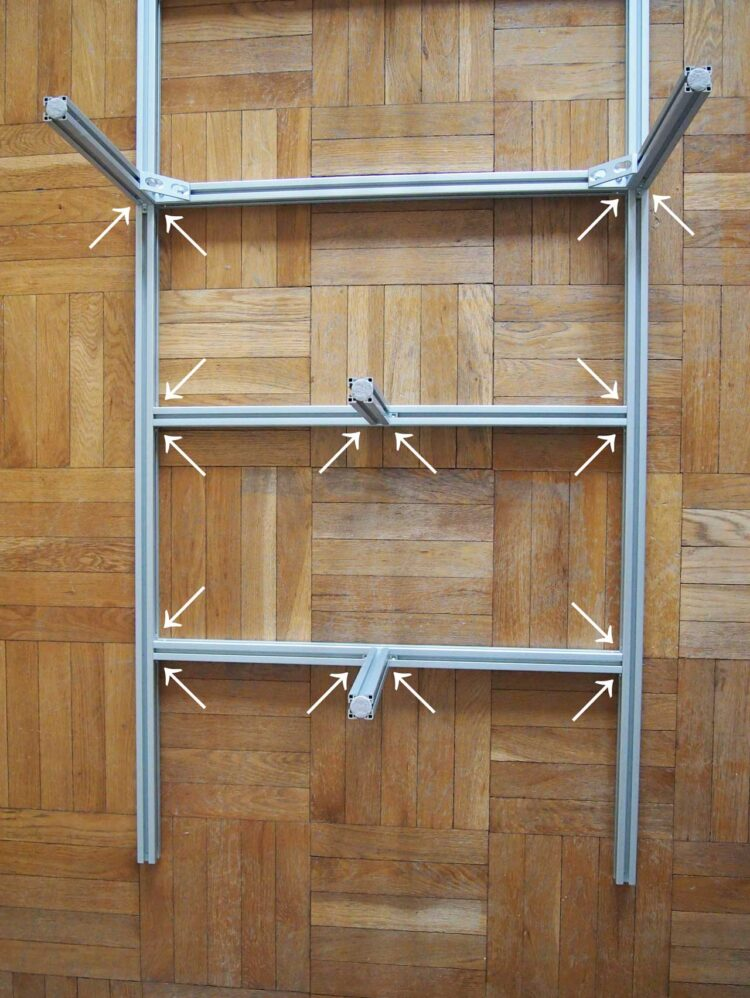 8   Repeat step 7 for the other side of the frame you have laid out. Also, place 1 large bracket on each of the 300mm parts in the center of the frame (shown at the top of the picture).