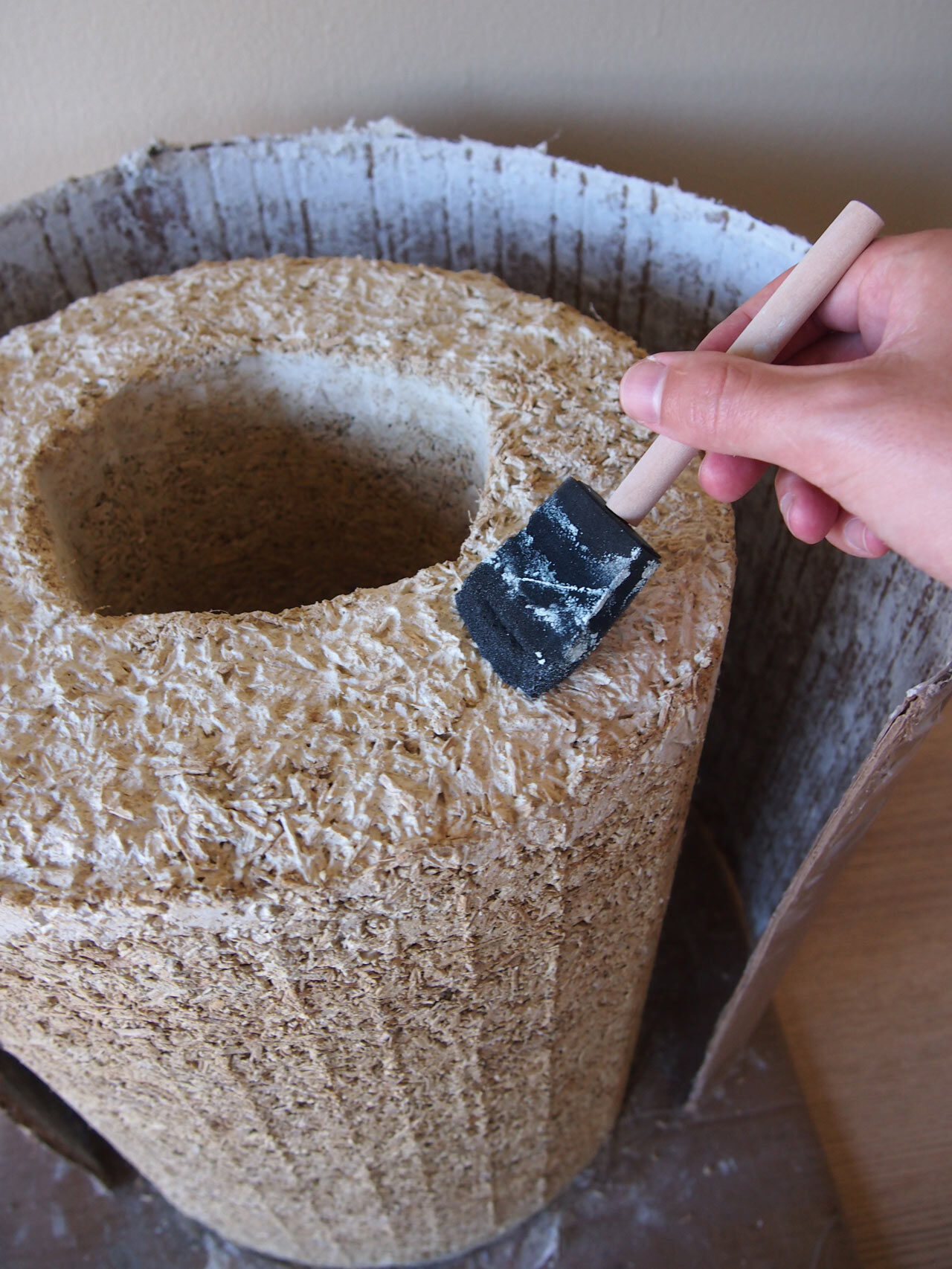 13   Boil some water in a saucepan and mix in some all purpose flour, making a thin papier-mâché paste. Wait for the mix to cool, and brush it all over the stool. It should dry clear and help keep the hemp from flaking off.