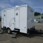 FOUR STATION PORTABLE RESTROOM TRAILERS EXTERIOR