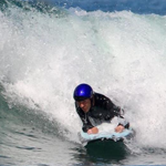 A surfer riding waves