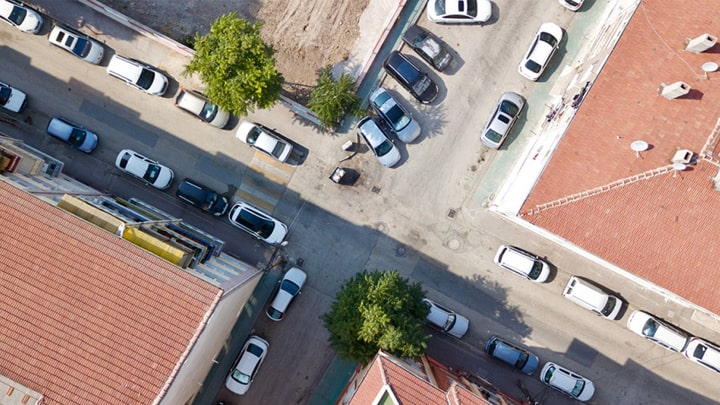 GNSS Positioning in Urban Areas A Key Technical Challenge for Drones and Self Driving Cars