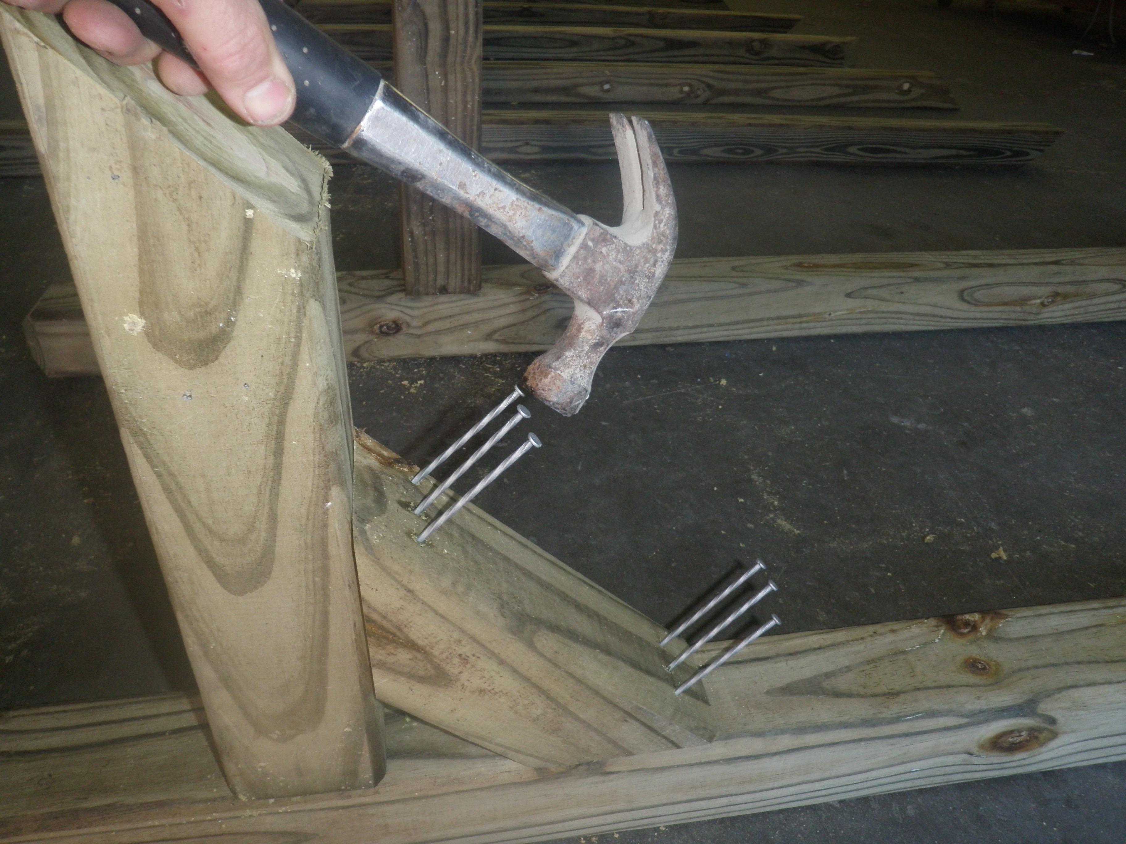 Hammering Twist Nails into the Cross Brace Mailbox Post