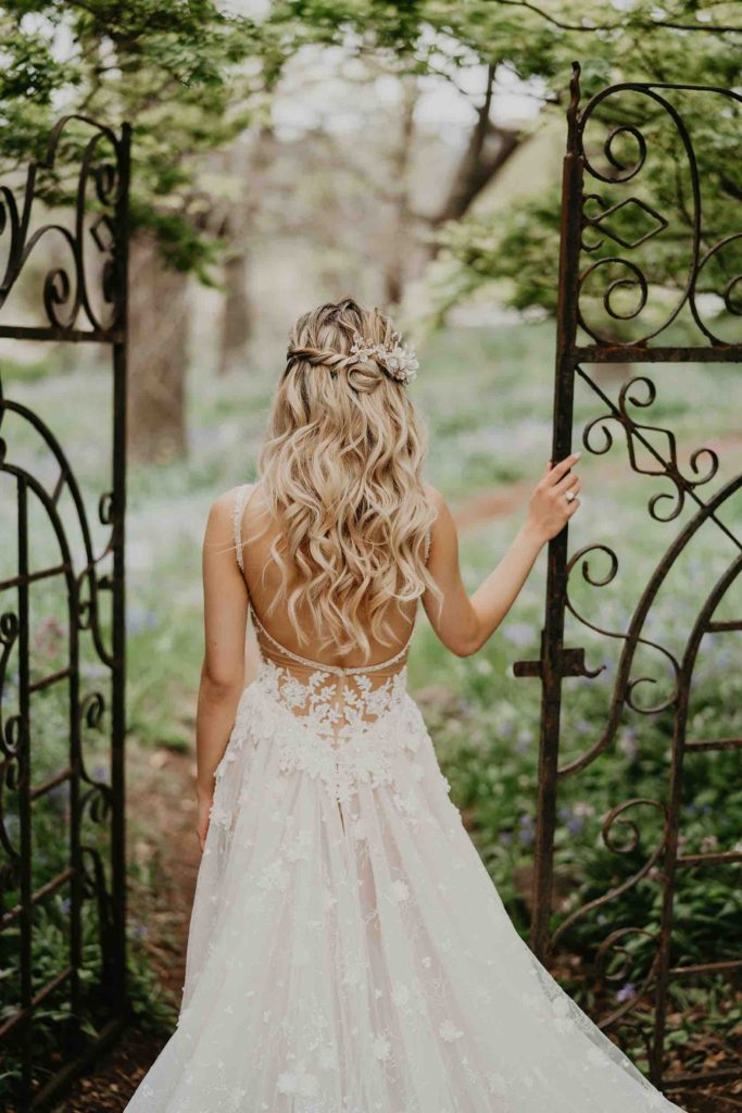 Bride at Milton Park iron gates