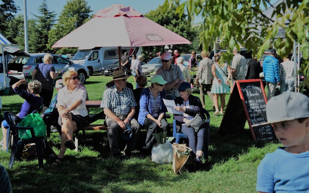 People sitting outdoors at the Marlborough Farmers Market