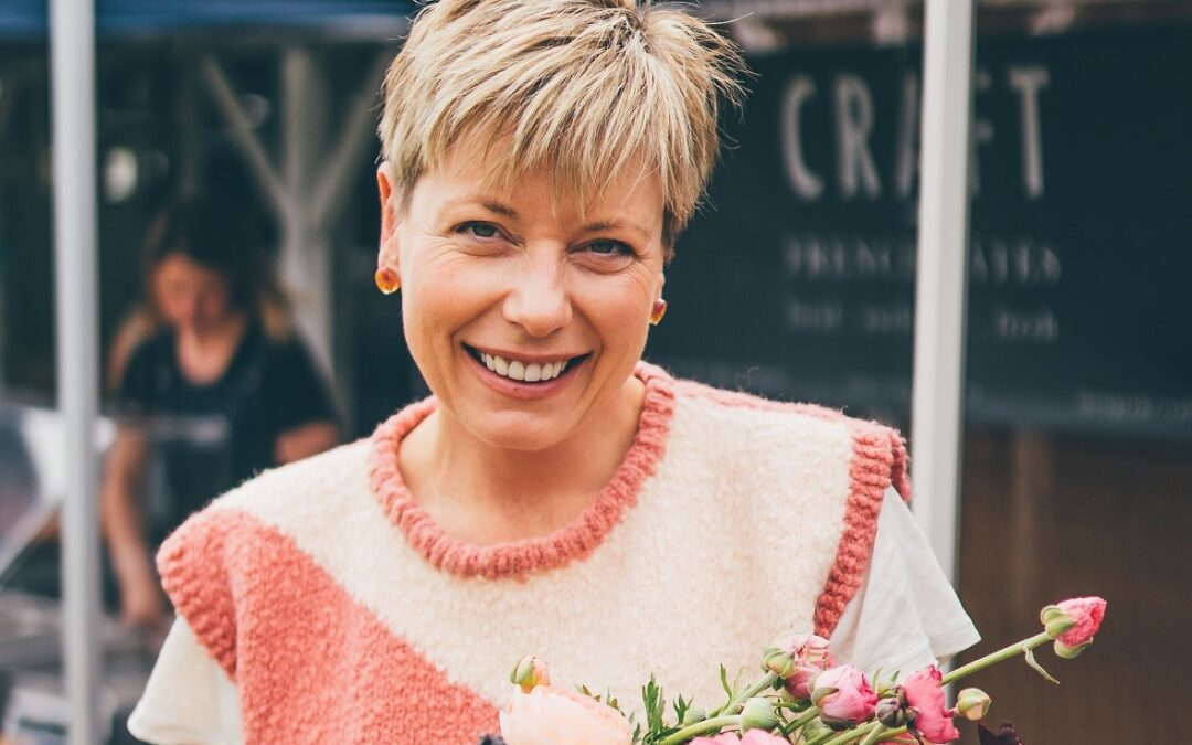 Jeanine of Verve with a bunch of organic flowers photo credit Jared Buckley