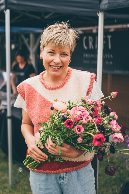 Jeanine of Verve with a bunch of flowers. Photo credit Jared Buckley