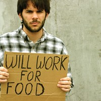 """Man with """"will work for food"""" sign"""