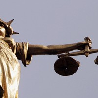 blind justice with scales statue
