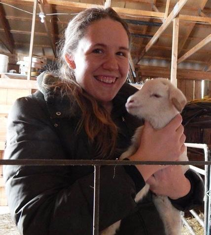 Heritage Farm's Tara Lynne Burns with lamb