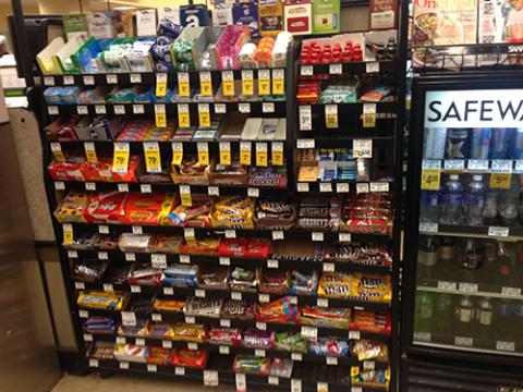 candy display and soda cooler in store, items possibly subject to new food stamp junk food ban
