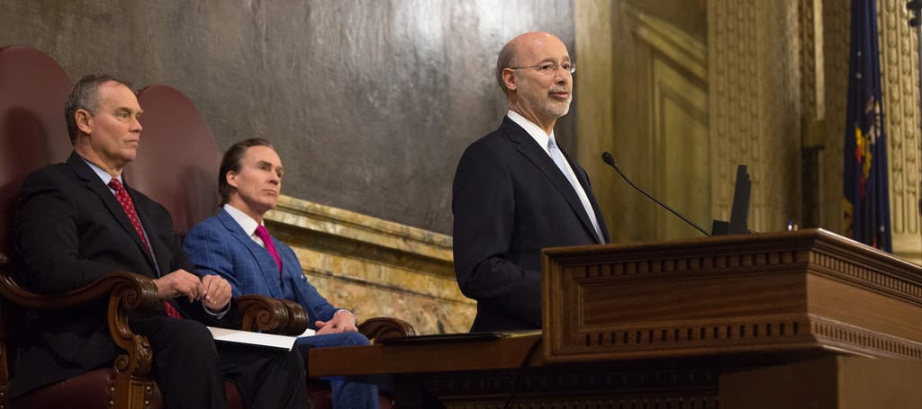 Gov. Wolf delivers his 2018-19 budget address in the Harrisburg capitol building, Feb. 6 with Lt. Gov. Stack and House Speaker Turzai seated behind him (via Flickr/GovernorTomWolf)