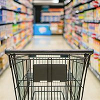 empty shopping cart in grocery store aisle