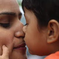 Immigrant mother and child embrace