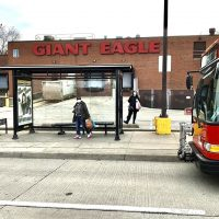Port Authority bus at stop in front of Giant Eagle grocery store