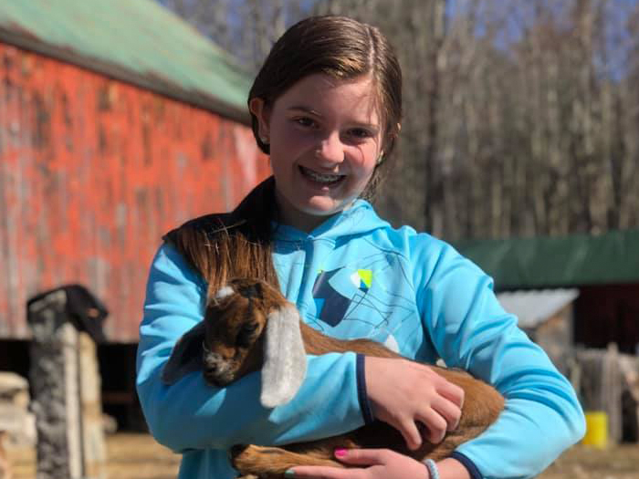 girl with baby goat