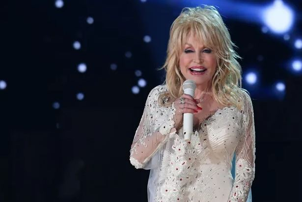 USA Today – Dolly Parton gives royalties from Whitney Houston's 'I Will Always Love You' to Black community