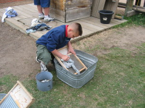Pioneer chores at the Four-Mile House Museum.