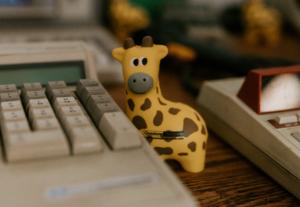 giraffe mascot figurine