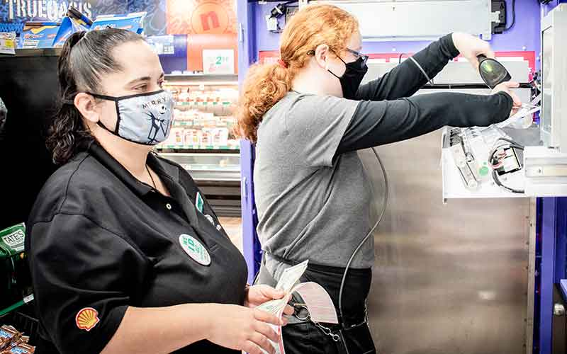 Quantum employee working with a C-store employee