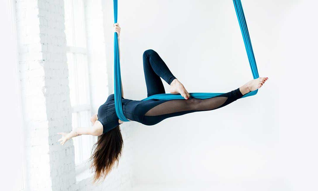 a girl having Aerial Yoga in Aerial Yoga Institute
