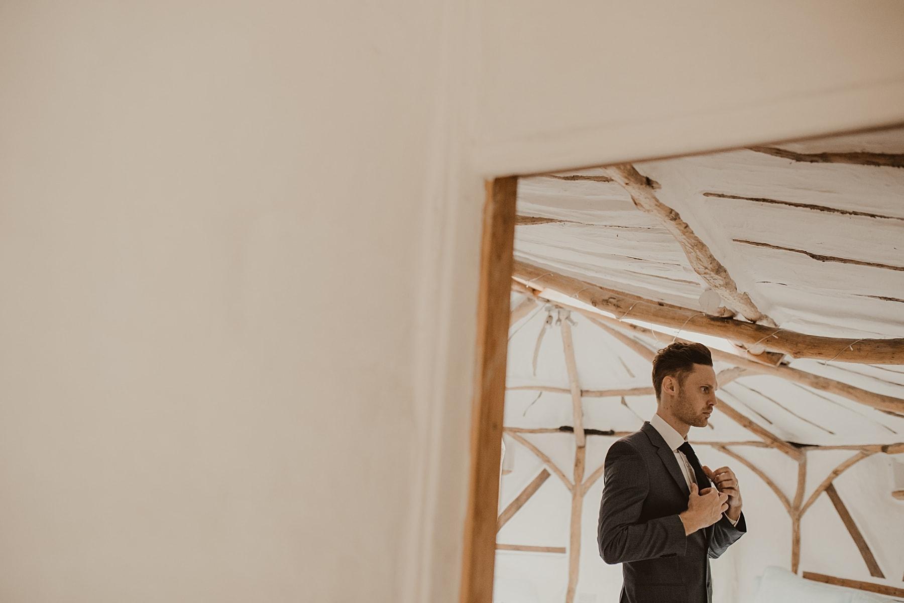 Best man getting ready in yurt