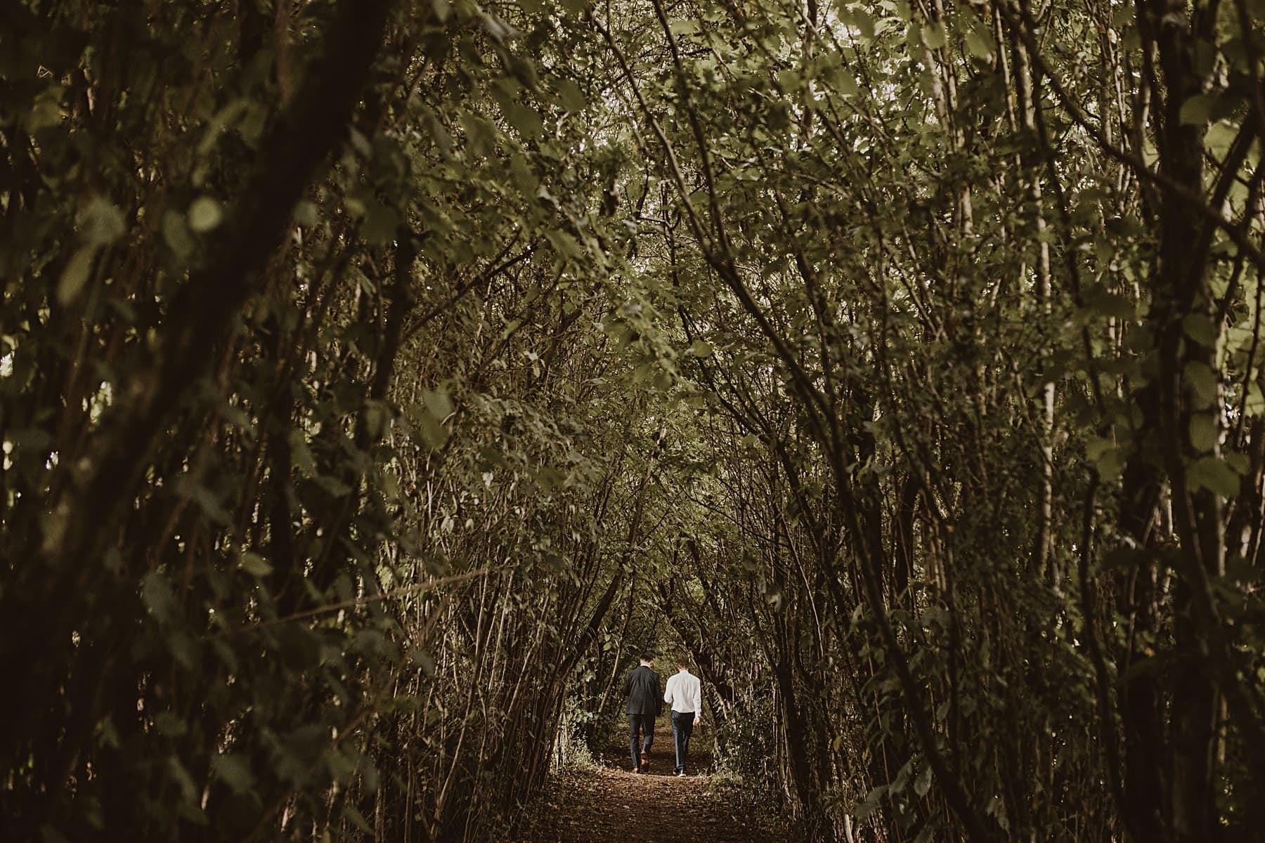 Nature corridor, men walking through