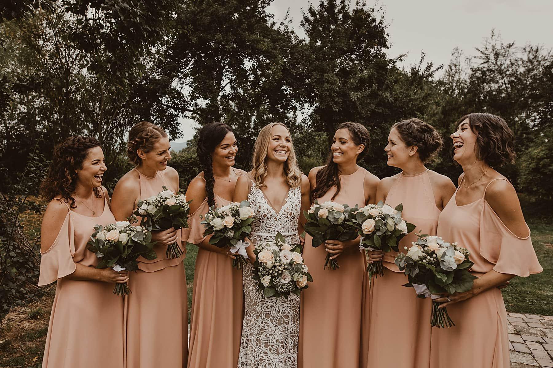 Bridesmaids laughing, rewritten dresses