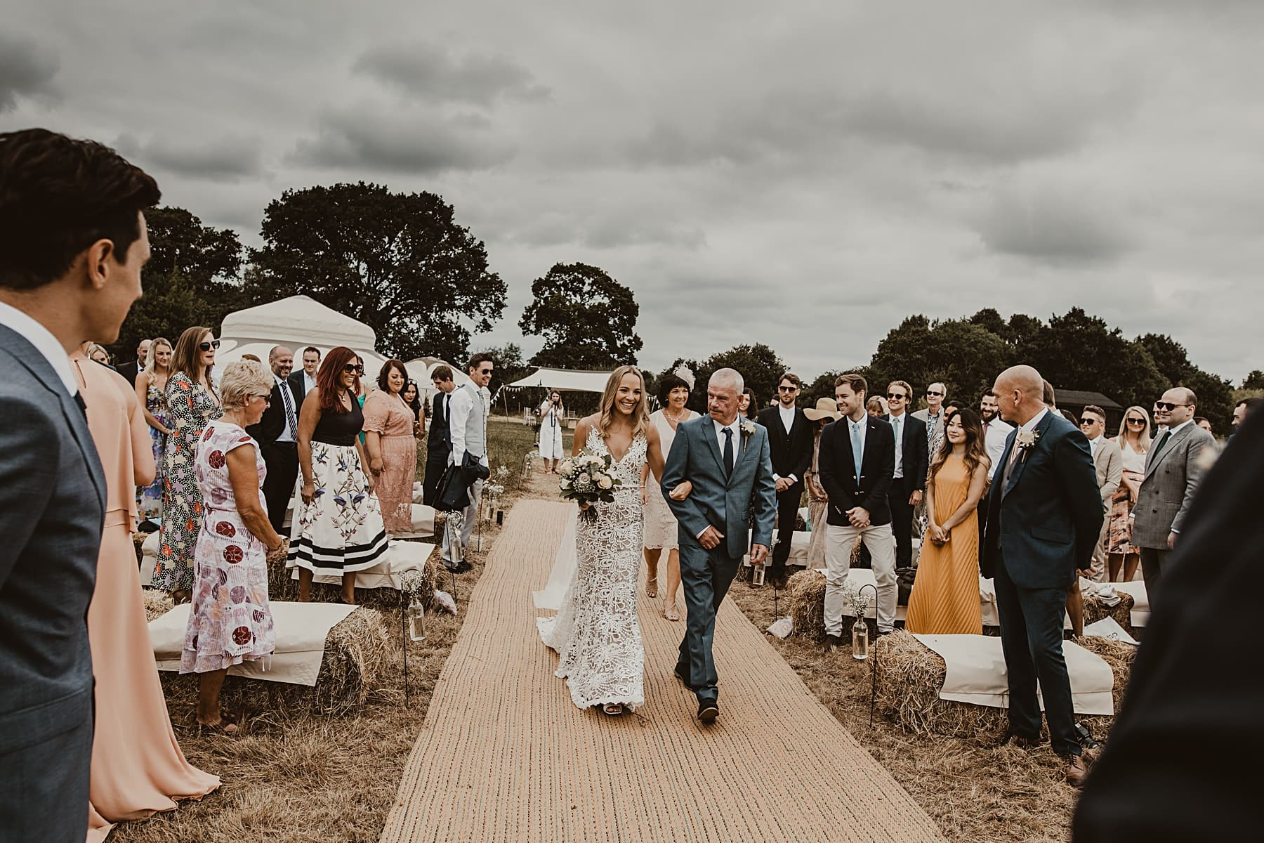 Bride walking down the isle to naked tipi