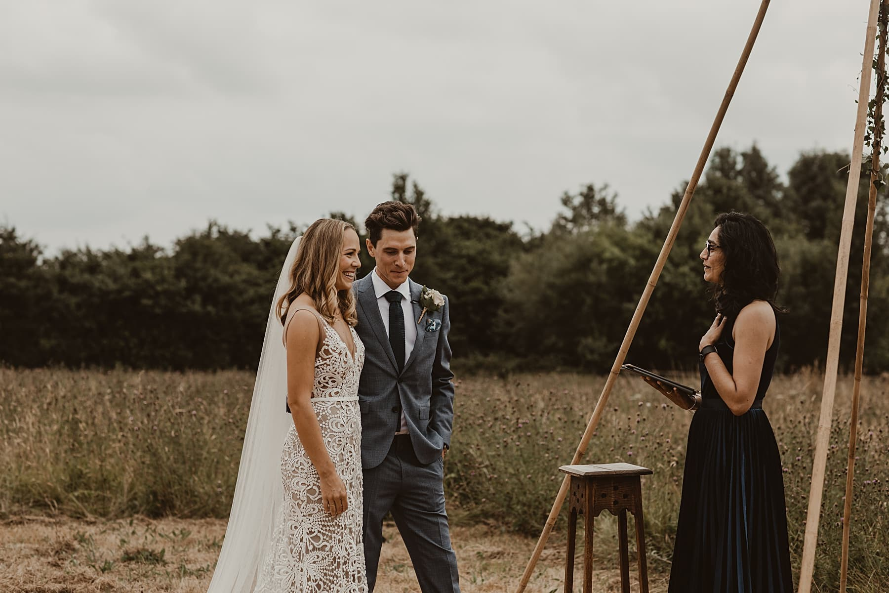 Bride and groom vows in front of naked tipi