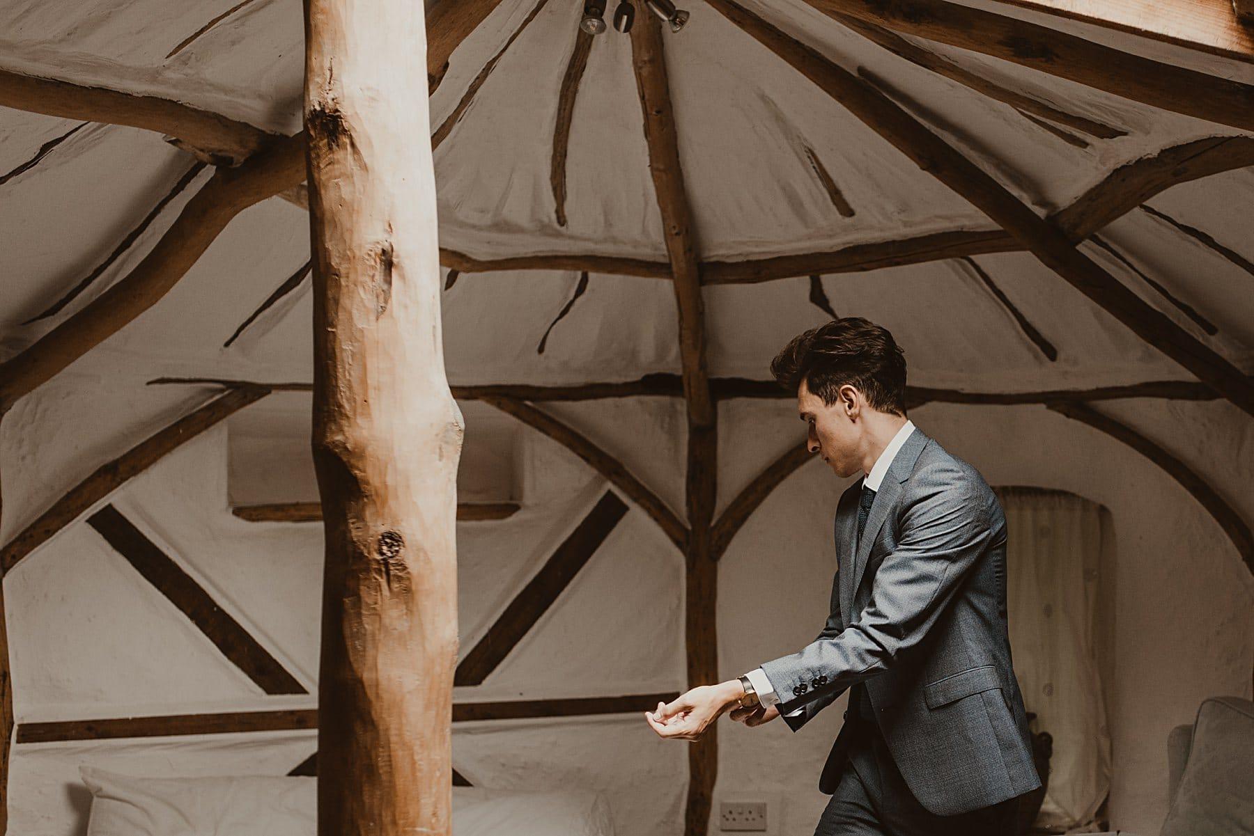 Groom getting ready in yurt