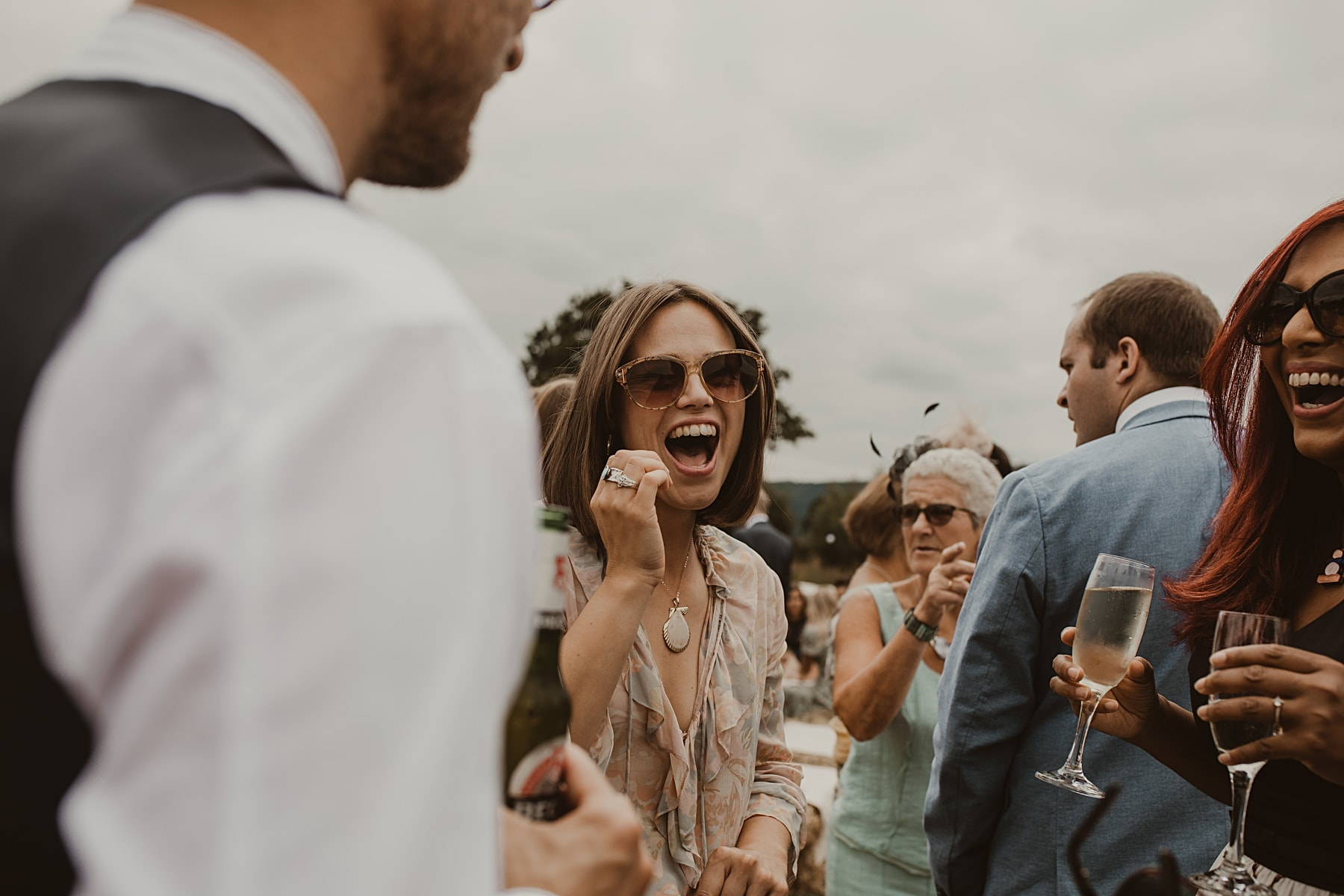 Wedding guest laughing - Natural wedding photographer