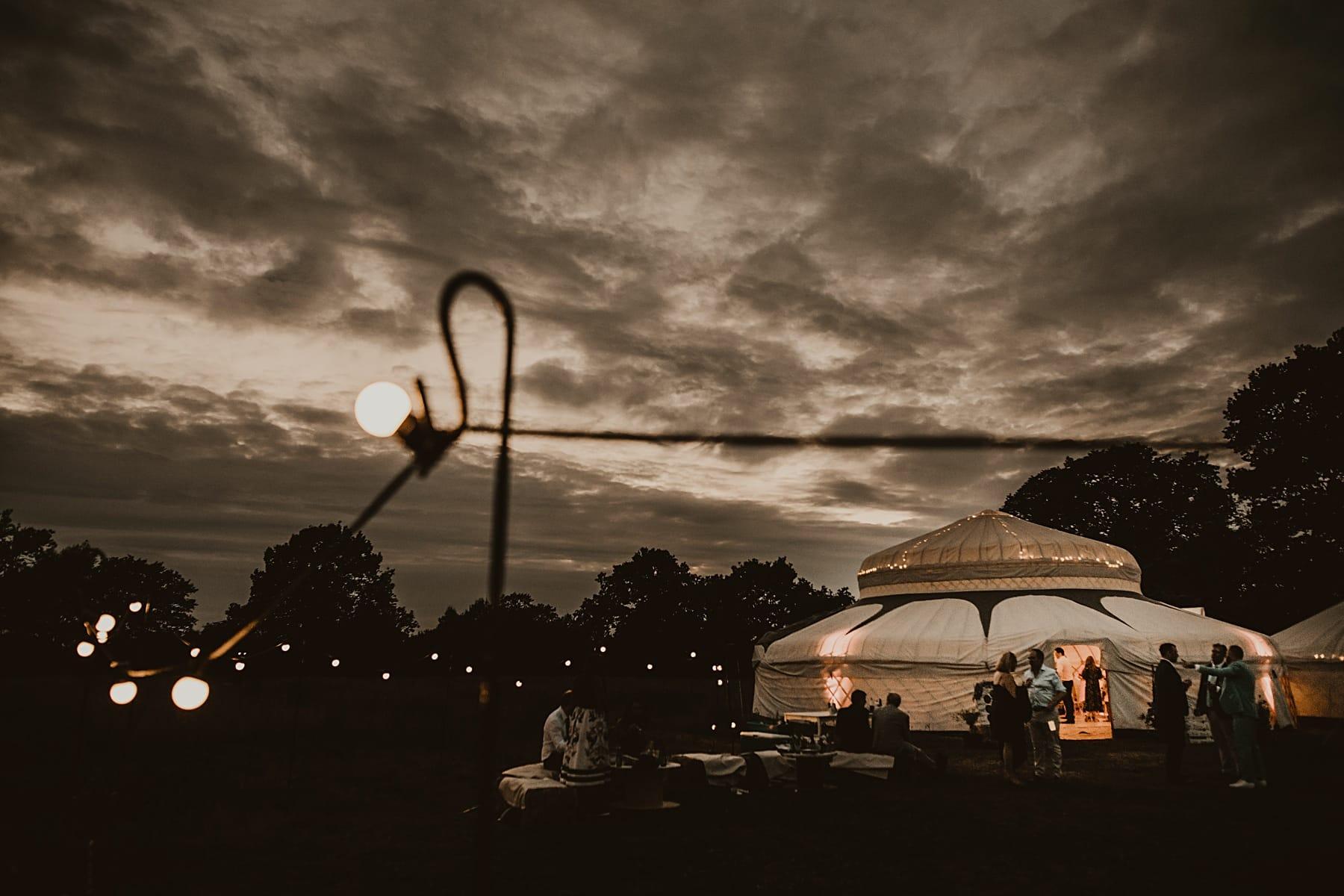 Yurt lit up at night with festoon lights