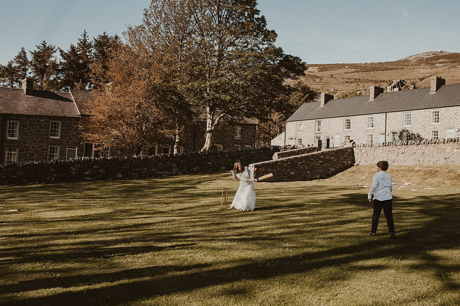 Bride playing cricket