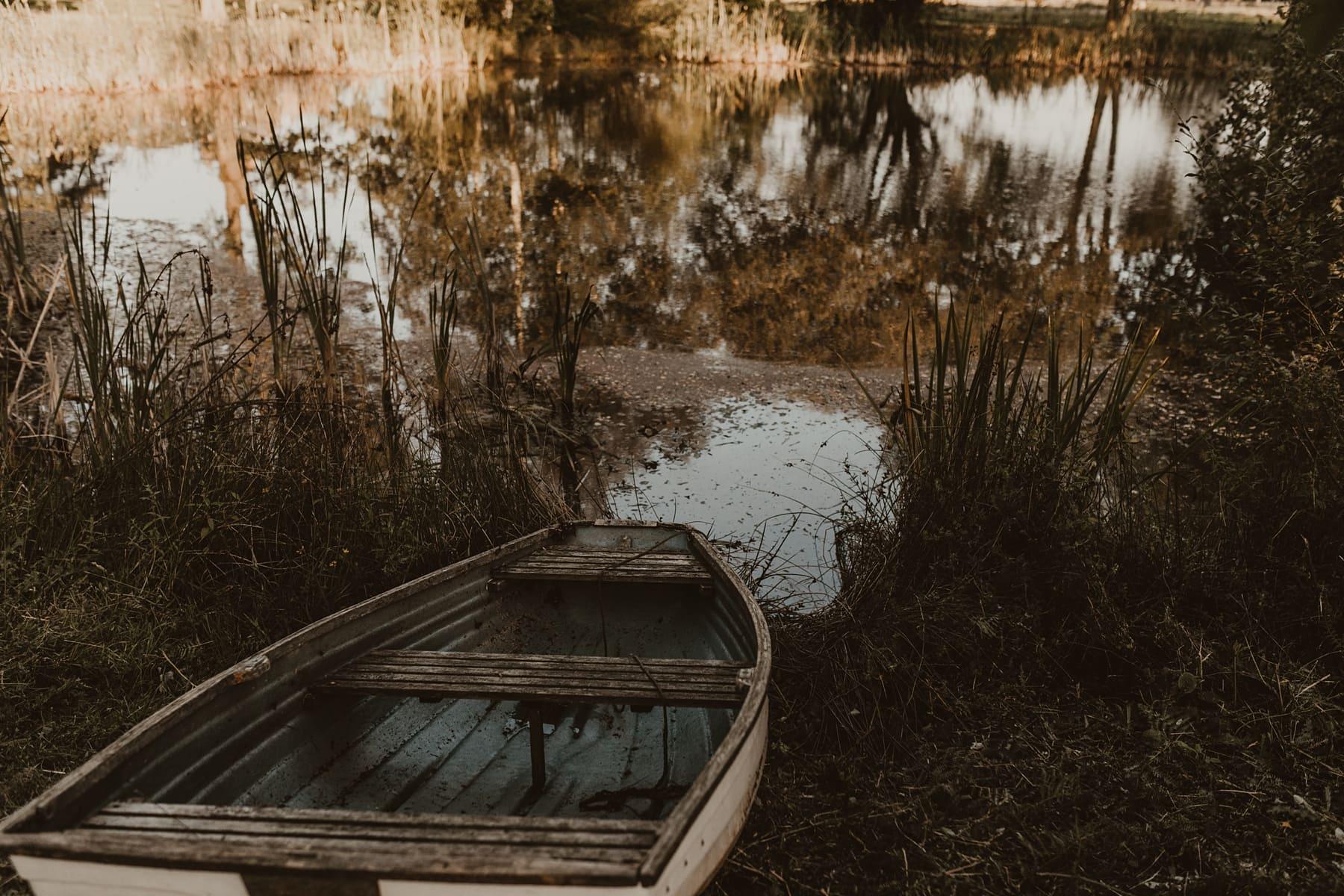 rowing boat next to lake
