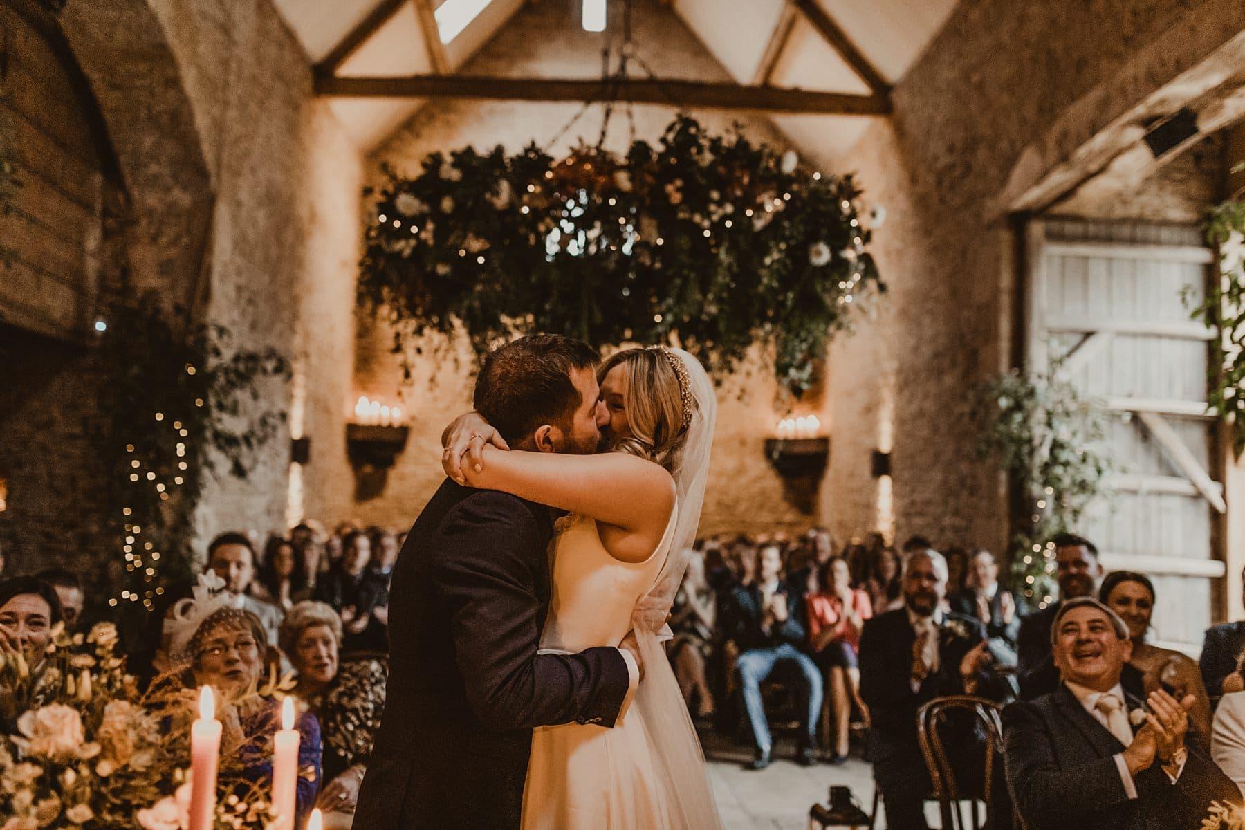 First kiss at Stone barn wedding