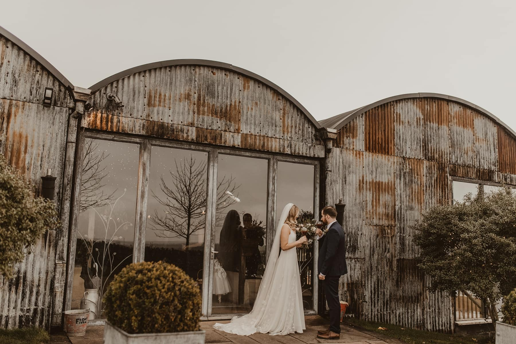 Bride and groom outside of Stone Barn, Cotswold